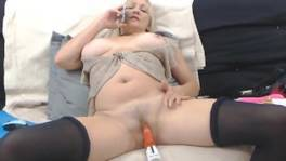 Horny blonde mother plays with big tits and teasing you