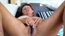 Horny MILF Pleasing her Pussy with a Vibrator
