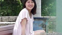 Squirting Japanese cutie finger fucked in public